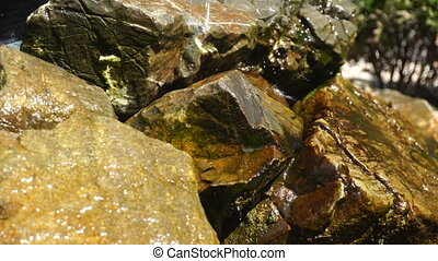 water drips on the stones - water from the fountain drips on...