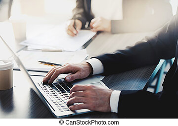 Businessman works with a laptop in office