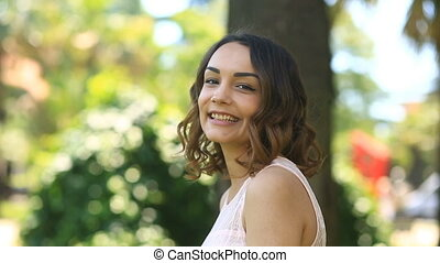 Beautiful young brunette girl with brown eyes cute smiling...