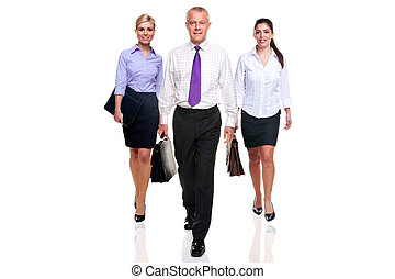 Business team three people walking - A team of three...