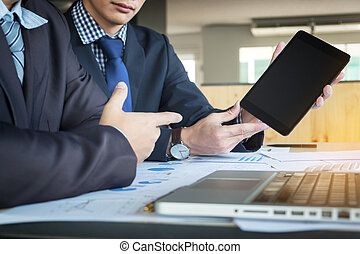 Images of businessman having a meeting in office using...