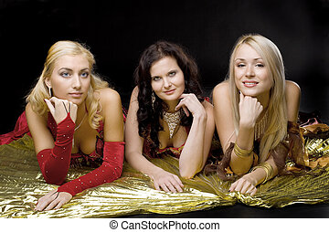Three young woman  on gold wing