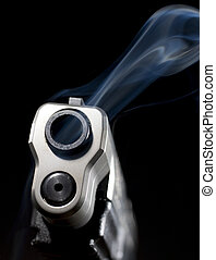Hot gun - Pistol that is still releasing smoke after a shot