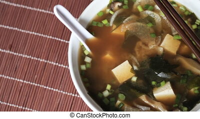 Tracking shot of big bowl of miso soup - Close up of big...