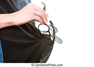 Man cleaning glasses on black t shirt