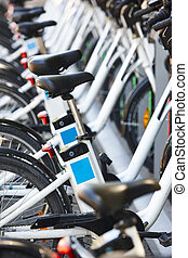Eco-friendly urban transport. Electric bikes charging batteries. Environmental