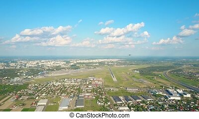 Scenic aerial shot of commercial airplane leaving an...