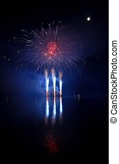 Firework. Beautiful colorful fireworks on the water surface...