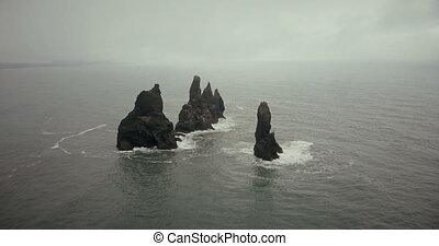Aerial view of troll toes mountains on the water in Iceland...