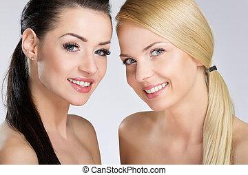 Two pretty women smiling