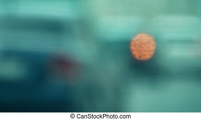 Telephoto lens shot, blurred road traffic. Bokeh motion...
