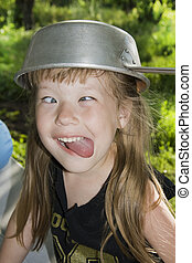 Sticking out tongue - little girl grimacing and sticking out...