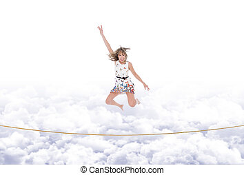 Girl jumps on the rope taut in the sky - Excited and winning...