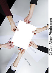 A female working group holds a blank sheet in her hand