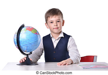 Schoolboy at the desk holding a globe of world, isolated on...