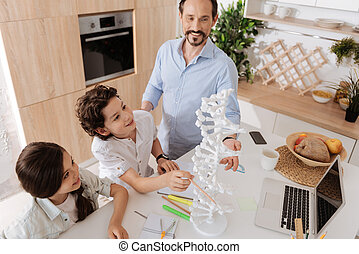 Lovely single-parent family getting ready for a biology...