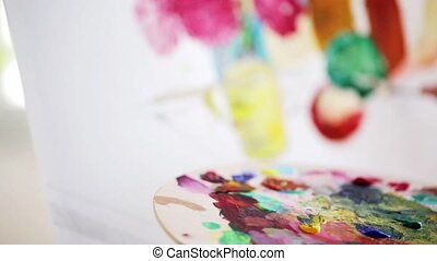 artist with palette knife painting at studio - art,...