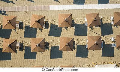 Beach,italy - Bird's eye view of colored umbrella in a beach...