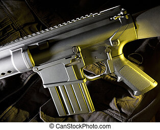 Assault rifle that is AR style with a yellow gel coming from...