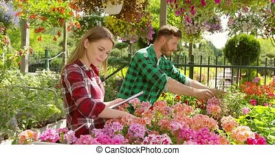 Cheerful coworkers in garden - Cheerful man working with...