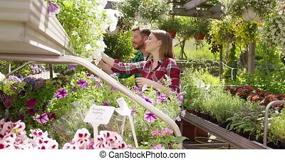 Cheerful coworking gardeners - Smiling woman and man working...