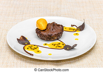 Chocolate tartlet with mango mousse and mango sorbet