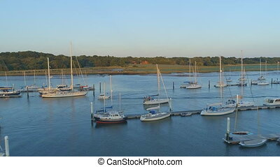 Aerial View of Yachts Moored in an Estuary at Sunset