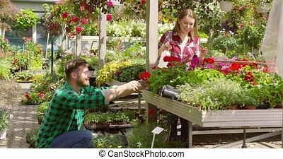 Smiling coworkers in garden together - Horizontal outdoors...