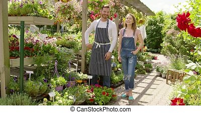 Cheerful coworkers in the garden - Horizontal outdoors shot...