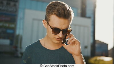 Young Man Talking Phone - Sexy hipster boy wearing blue...