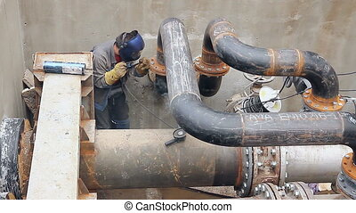 View on welder until welding pipeline junction - Welder is...