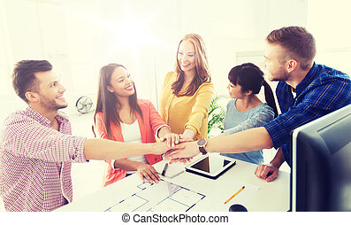 creative team holding hands together at office - business,...