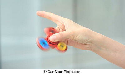 Multicolored, red-yellow-blue hand spinner, or fidgeting...
