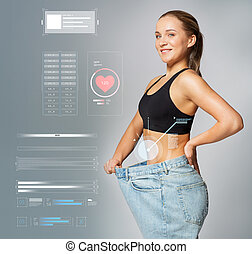 young slim sporty woman in large size pants - healthy...