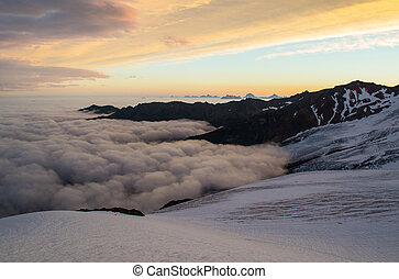Sunrise in the Mountains - Sunrise over a sea of coulds on...
