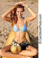 Beautiful sporty surfer girl at the beach. - Portrait of a...