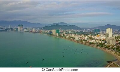 Aerial View of City with Skyscrapers on Azure Sea Coast -...
