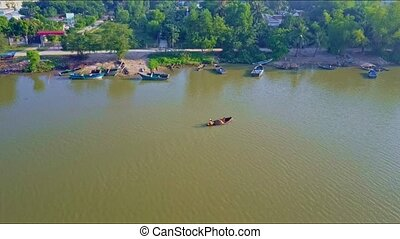 Aerial View Small Boat Sails on Green Calm River to Piers -...