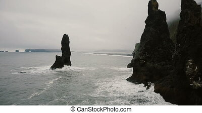 Aerial view of the black volcanic beach and troll toes rocks...