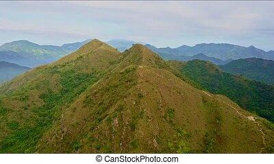 Drone Flies Slowly over High Brown Peaks of Mountain Ridge -...