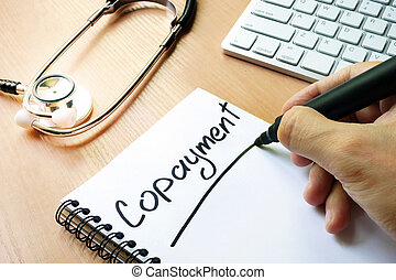 Handwriting sign copayment in a note.