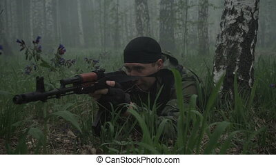 Armed military man in forest