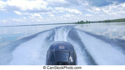 Trail on water surface behind of fast moving motor boat. the motor of motor boat, back view. Sea water ship trail with white foamy wave. Tropical islands ferry travel. Cruiseliner seawater trail. Deep ocean top view