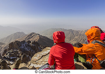 The peak whit 4,167m is the highest in the Atlas mountains and North Africa, trekkers relaxing and appreciating view.