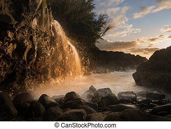 Waterfall near Queens Bath in Princeville Kauai - Setting...