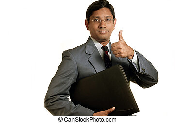 Businessman - An handsome Indian businessman smiling...