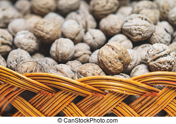 lot of walnuts in braided basket close up