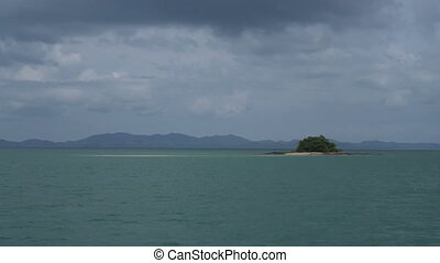 Small island on the sea - View from boat on panorama over...