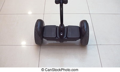Hyroscooter in shopping center. Personal eco transport.