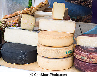 Natural cheeses made in the traditional way in a market...